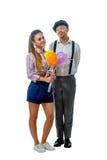 Jeune homme dans un chapeau et une femme en bref Photo libre de droits