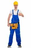 Jeune homme de sourire dans l'uniforme de construction Photographie stock libre de droits