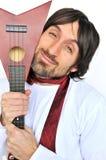Jeune homme drôle avec l'ukulele Image stock