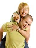 Jeune homme effectuant son dos mignon de fille Photographie stock