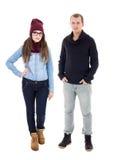 Jeune homme et femme dans des vêtements d'hiver d'isolement sur le blanc Image libre de droits
