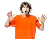 Jeune homme faisant des gestes la verticale étonnée Photographie stock libre de droits
