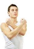 Jeune homme faisant des gestes le symbole de combat. D'isolement sur le petit morceau images libres de droits