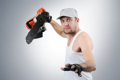 Jeune homme fou avec la scie électrique Photo libre de droits