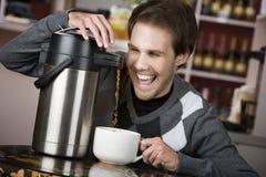 Jeune homme fou par café Photographie stock libre de droits