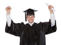 Jeune homme gai de graduation Image libre de droits