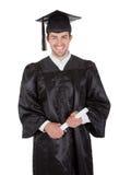 Jeune homme gai de graduation Photographie stock
