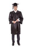 Jeune homme gai de graduation Photos stock