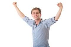 Jeune homme heureux avec des bras vers le haut dans le geste de victoire Images libres de droits