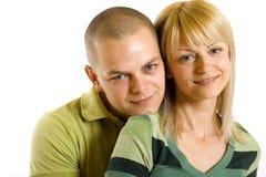 Jeune homme heureux et femme restant ensemble Photos libres de droits