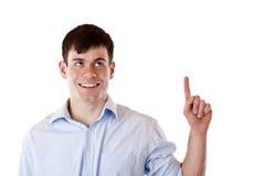 Jeune homme heureux se dirigeant avec le doigt au copie-espace Photos stock