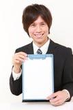 Jeune homme japonais avec la table des messages Photos libres de droits