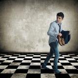Jeune homme marchant furtivement Images stock