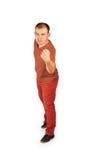 Jeune homme montrant son poing Image libre de droits