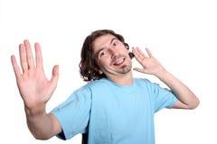 Jeune homme occasionnel avec un visage drôle Image libre de droits