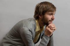 Jeune homme pensant aux succes Photographie stock