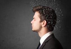 Jeune homme pensant avec les lignes et les symboles abstraits Photo stock