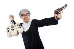 Jeune homme portant comme nonne d'isolement sur le blanc Photos stock