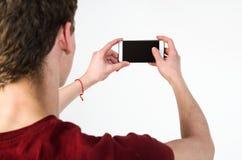 Jeune homme prenant le selfie Photographie stock
