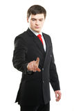 Jeune homme réussi d'affaires appuyant sur le bouton imaginaire image libre de droits
