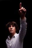 Jeune homme recherchant à la lumière et au pointage Photographie stock