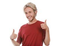 Jeune homme satisfait renonçant au pouce Image libre de droits