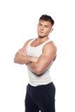 Jeune homme sportif dans la chemise blanche Image stock