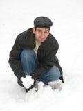 Jeune homme sur la neige Photo stock