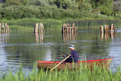 Jeune homme sur le bateau Photo libre de droits