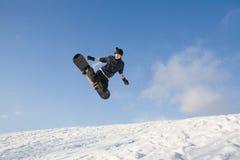 Jeune homme sur le snowboard Photo libre de droits