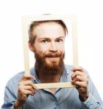 Jeune homme tenant le cadre de tableau Images libres de droits