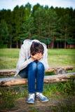 Jeune homme triste Photographie stock libre de droits