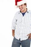 Jeune homme utilisant le chapeau de Santa photographie stock libre de droits