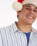 Jeune homme utilisant le chapeau de Santa images libres de droits