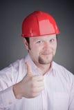 Jeune ingénieur avec le pouce vers le haut Photographie stock libre de droits
