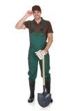 Jeune jardinier heureux dans la salopette Image stock