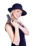 Jeune joli femme avec un canon Photographie stock libre de droits