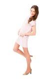 Jeune jolie femme mince dans la pose rose de robe Photo libre de droits
