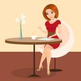 Jeune jolie femme seul s'asseyant dans le café et à l'aide d'un PC de comprimé illustration stock