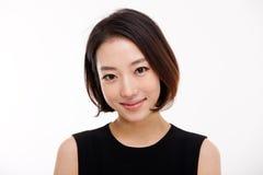 Jeune jolie fin asiatique de femme d'affaires vers le haut de verticale. Photo libre de droits