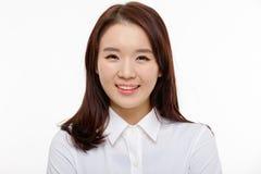 Jeune jolie fin asiatique de femme d'affaires vers le haut de verticale Photographie stock libre de droits