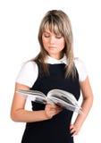 Jeune livre de relevé de femme d'affaires Image libre de droits