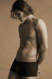 Jeune mâle dans la sépia de sous-vêtements Photos stock