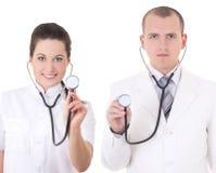 Jeune mâle et médecins féminins avec des stéthoscopes d'isolement sur le petit morceau image libre de droits