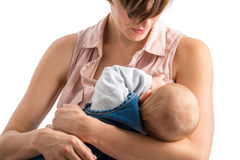 Jeune mère dévouée allaitant son bébé nouveau-né Images libres de droits
