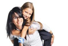 Jeune mère jouant avec le descendant. Sur le blanc Photo stock