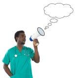 Jeune mégaphone de petit morceau de docteur photo libre de droits
