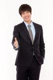 Jeune main étendante d'homme d'affaires à la secousse Image stock