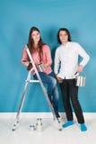 Jeune maison de peinture de couples Photos libres de droits
