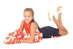 Jeune majorette de lycée fixant avec des poms de pom Images stock